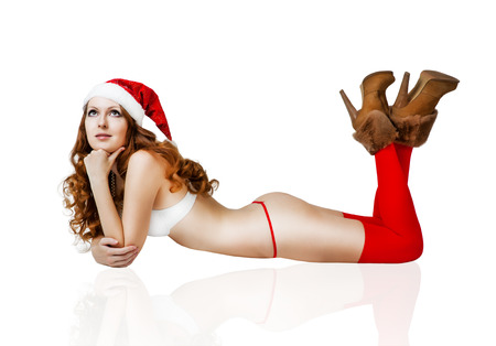 Sexy christmas girl in red santa claus hat and bikini isolated on white background photo