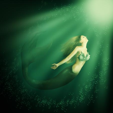 cola mujer: sirena hermosa mujer con cola de pez y largo desarrollo de la nataci�n del cabello en el mar bajo el agua