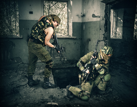 stormed: Soldiers in full gear stormed the building  Stock Photo