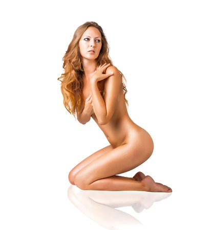 Sexy fit naked woman with healthy clean skin and beautiful long hair sitting, isolated on white  Stock Photo - 30582006