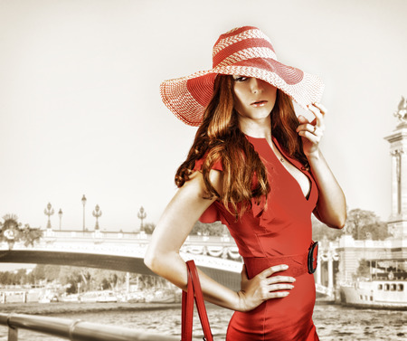 Young sexy fashionable woman wearing red hat and dress photo