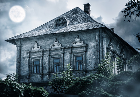 abandoned house window: Halloween concept. old abandoned empty house in forest Stock Photo