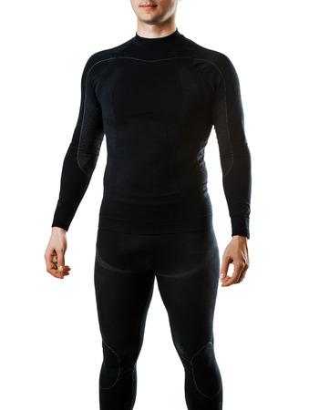 Mannelijke zwarte thermisch ondergoed voor actieve wintersport. Man dragen Thermolinen geïsoleerd op witte achtergrond Stockfoto
