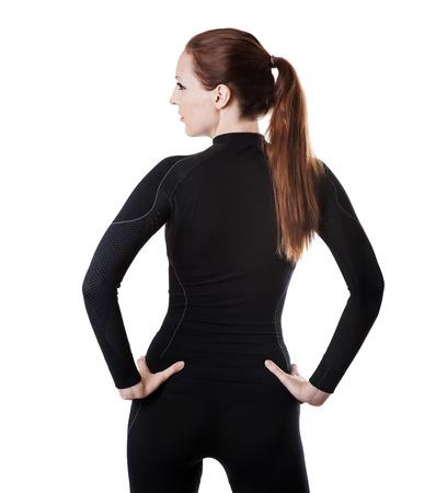 femme en sous vetements: Belle femme sexy en noir sport chaudes thermolinen sous-v�tements pour le ski alpin isol� sur fond blanc rester en arri�re