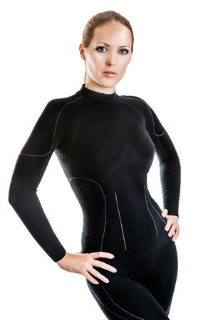 niñas en ropa interior: Hermosa mujer sexy en ropa interior de los deportes calientes thermolinen negro para el esquí alpino aislado en fondo blanco