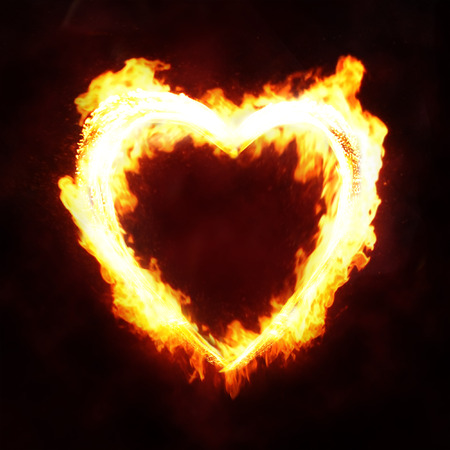 heart in flame: Valentines day or hot love concept - fire heart