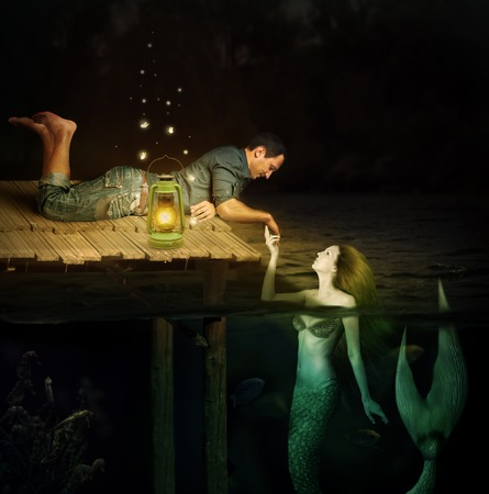 Love between handsome men and beautiful mermaid. Jetty in water