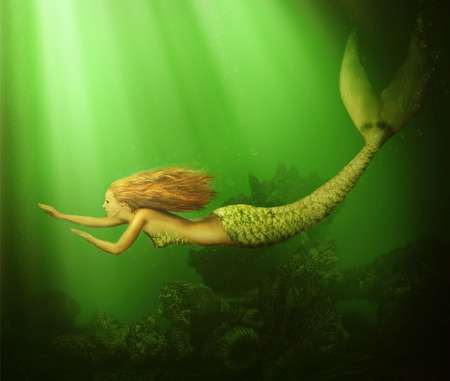 mermaid: Fantasy. beautiful woman mermaid with fish tail and long developing hair swimming in the sea underwater Stock Photo