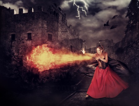 fireball: beautiful woman witch trains in medieval castle cast magic  fireball