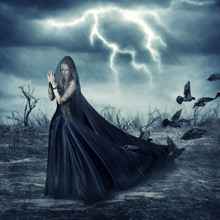 mage: Fantasy world  beautiful woman in black fashionable medieval dress and pigeon birds