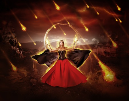 blazing: woman fire mage in medieval dress with developing mantle conjured fiery meteor rain