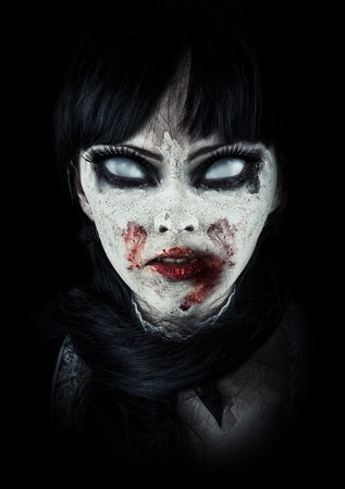 Scary zombie woman  with white eyes and bloody mouth photo
