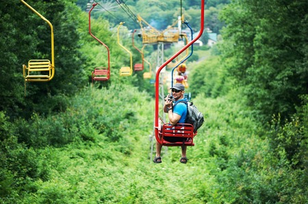 summer beauty: Tourist going on Cable car funicular from the mountain Kizilovka to the lake in Atazhukinsky garden in Nalchik