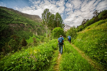 trekking pole: Tourists and climbers with trekking pole are on the mountain Cheget, Kabardino-Balkaria Republic, Russia. Caucasus Mountains