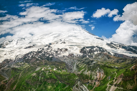 elbrus: Mount Elbrus in clouds. View from top of Cheget mountain