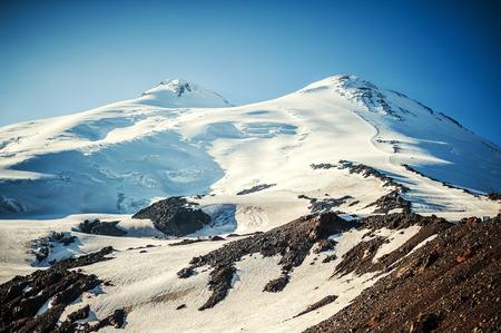 elbrus: The western and eastern peaks of mount Elbrus closeup - 5642 meters and 5621 meters. Caucasus mountains