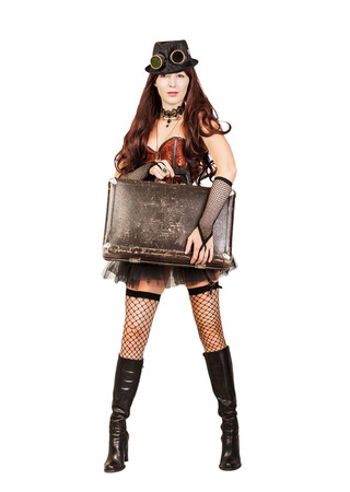 stay beautiful: Portrait of a beautiful steampunk woman traveler stay full height and holding retro suitcase isolated on white background