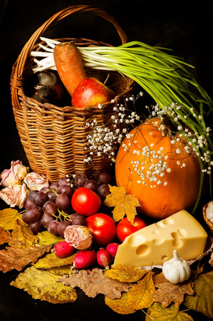 harvest background: Natural dairy rural products set - autumn vegetable harvest - radishes, tomatoes, etc. on a blck background Stock Photo
