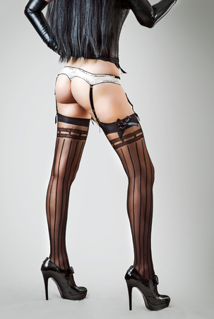 stockings woman: Sexy long legs in stockings of beautiful slender woman