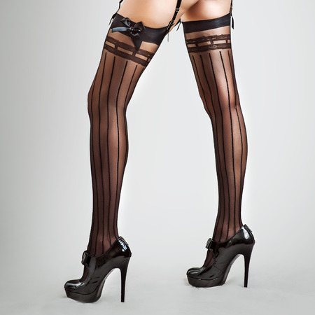 Sexy long legs in stockings of beautiful slender woman
