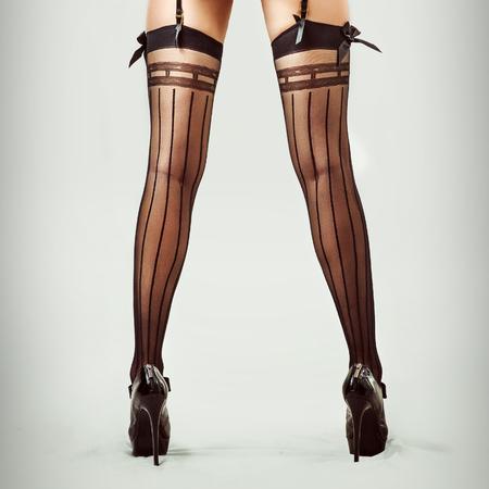 female legs: Sexy long legs in stockings of beautiful slender woman