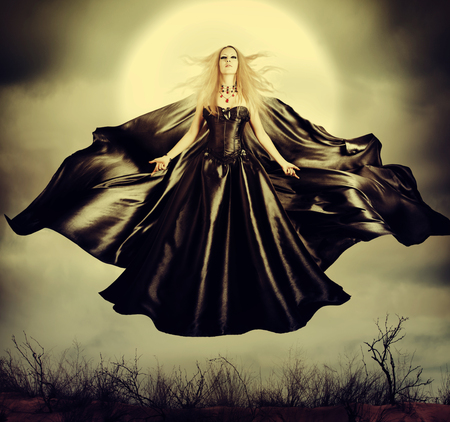 mage: Beautiful woman - flying halloween witch in midnight outdoor about full moon with black developing cloak Stock Photo