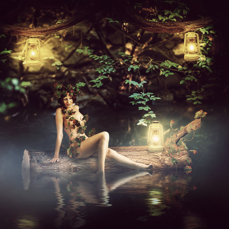 sea nymph: Fantasy fairytale beautiful woman - wood nymph or dryad sitting about water, sail on a log Stock Photo