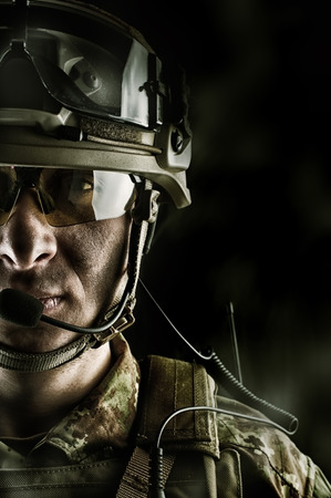 guerilla: Young handsome military man in italian camouflage wearing helmet, glasses and radio set Stock Photo