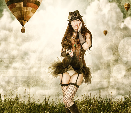 worn card in sepia retro style. Beautiful young steampunk woman wearing old-fashioned fantasy clothes outdoor. Balloons flying in sky in background Stock Photo