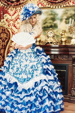 Beautiful woman wearing princess costume in luxury aristocratic interior photo