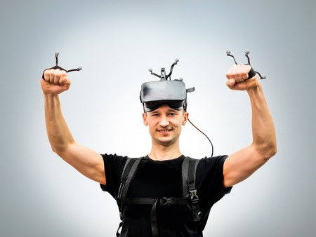Standard equipment guy in virtual reality attraction club after game posing inside room