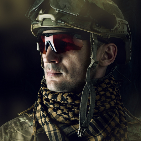 close up portrait of handsome military man. Macro shot on black background