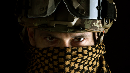 close up portrait of handsome military man. Macro shot on black background in scarf on face Stock Photo
