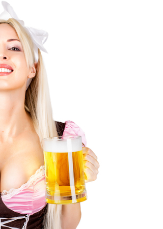 Young beautiful blond oktoberfest woman with big neckline on female breast Holds mug with light beer