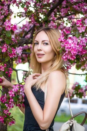Young beautiful woman in Japan sakura garden Stock Photo