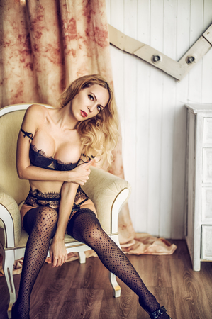 woman model in room in sexy lace lingerie