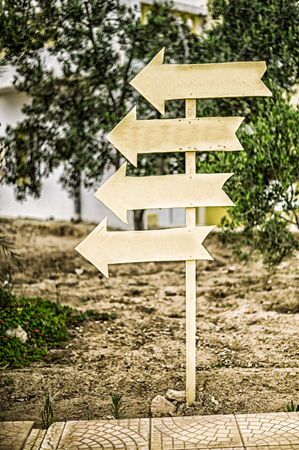 direction indicator. wooden signpost. Directions four signs to one place or way Stock Photo
