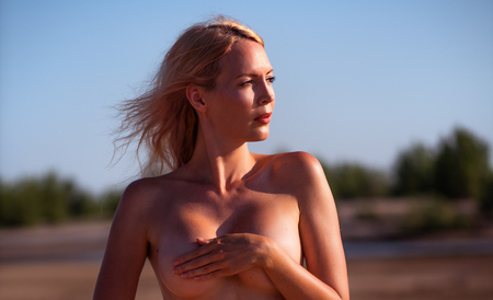 Beautiful girl model on sandy beach of the sea
