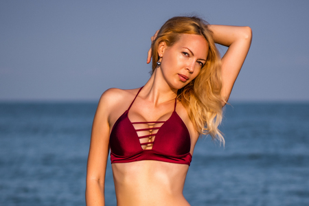 Beautiful girl model on sandy beach