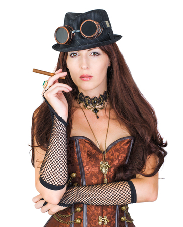 Sexy girl wearing steampunk costume and holding cigar isolated on white background 写真素材