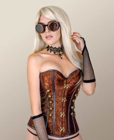 Portrait of sexy girl wearing steampunk costume with corset in studio Standard-Bild