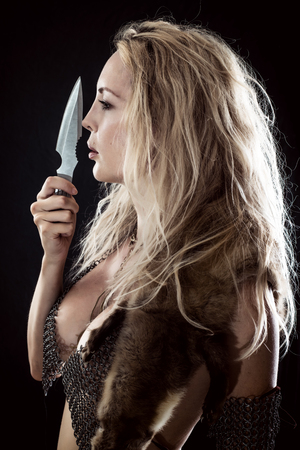 Girl Viking or Amazon. Throwing Knife in hand