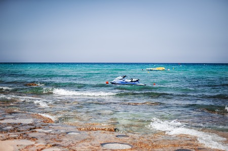 Water bike or jet ski on sea or ocean waves on resort