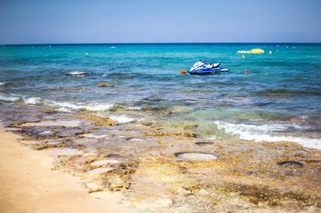 Focus on water. Water bike or jet ski on sea or ocean waves on resort