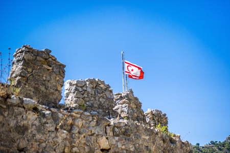Beautiful summer view on mountain on Kyrenia, St. Hilarion Castle and flag of turkish republic of northern cyprus Stock Photo