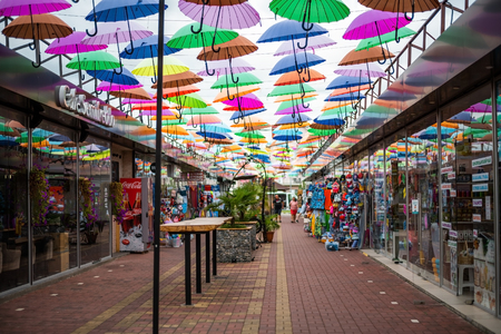 ADLER, RUSSIA - SEPTEMBER, 2018: alley soaring Umbrellas in Sochi. This location is popular with tourists.