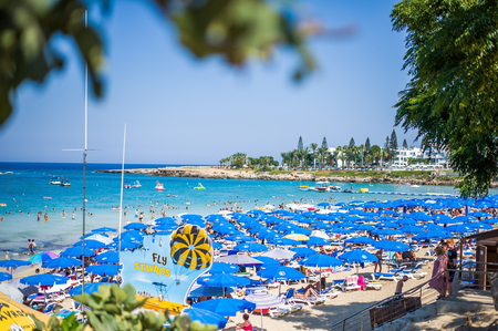 PROTARAS, CYPRUS - AUGUST 09, 2018: beautiful beaches of Protaras resort in summer with tourists relaxing on sand and in the sea