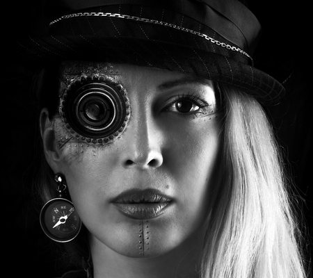 Steampunk girl portrait on black. Monocular lens on eye implant