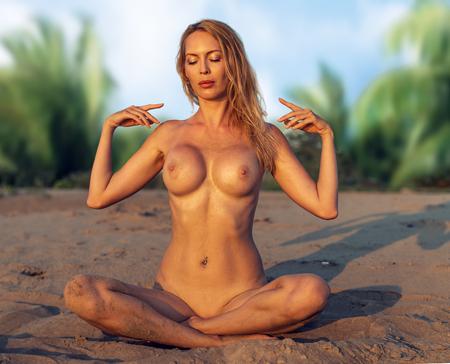 Beautiful girl model on sandy beach of the sea or ocean on tropical resort in summer