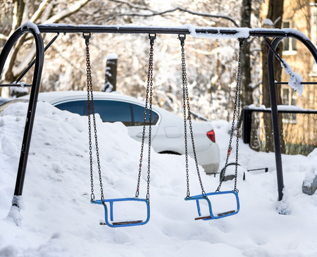Snow drifts and debris on the playground in one of the cities of Russia in the winter 스톡 콘텐츠